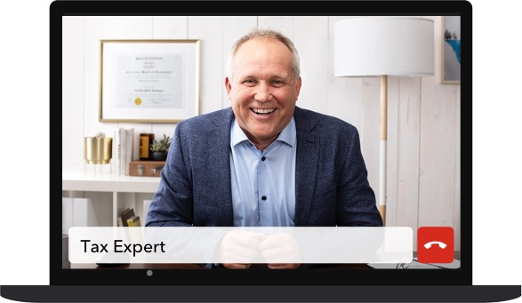 Self-employed tax expert on laptop screen